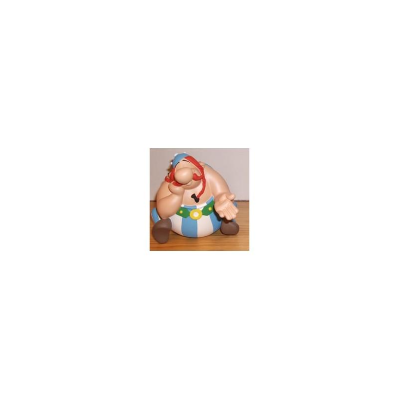 Asterix beeld Obelix zittend