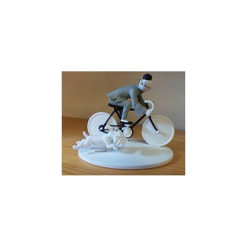 Kuifje  beeldje Zwart-wit Bobbie + Kuifje op de fiets (Blauwe lotus pag. 65)